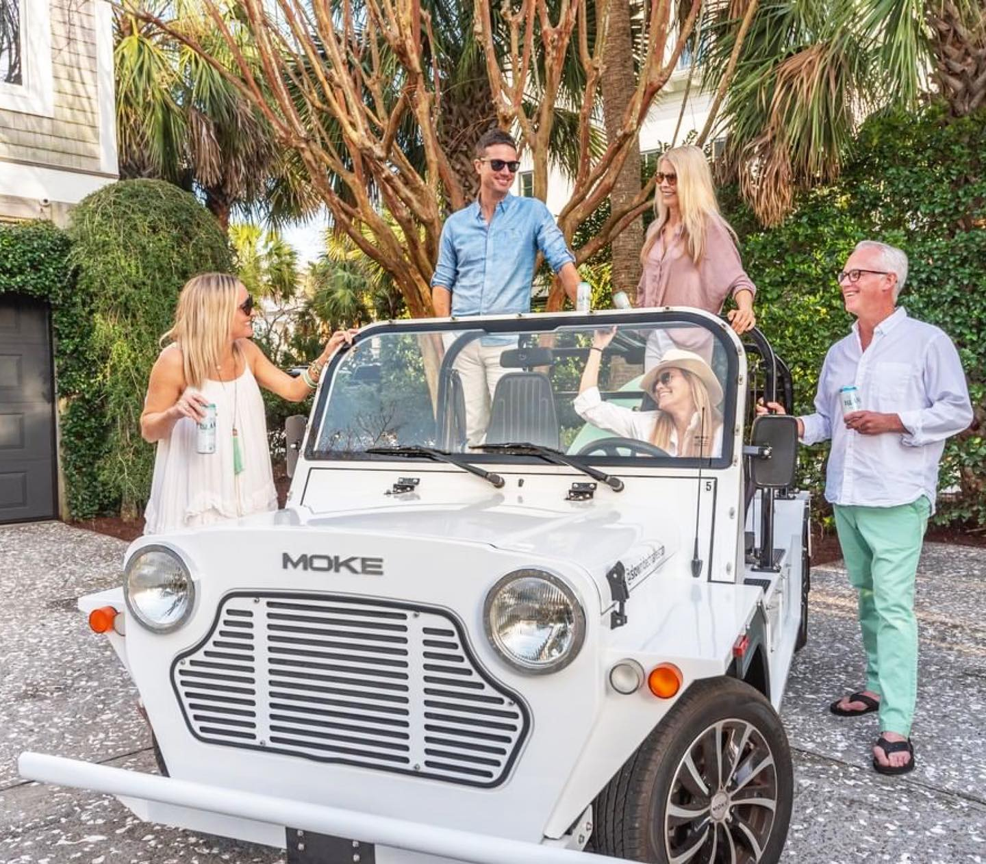white Moke with friend and family