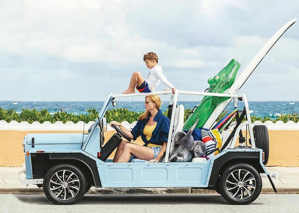 mother and son in a Moke at the beach