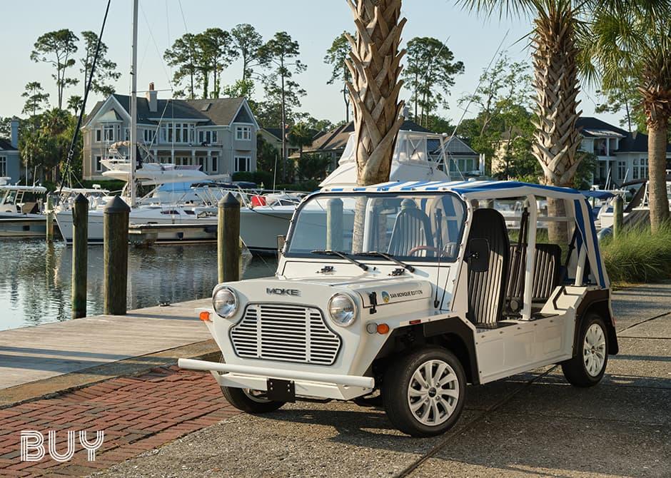 Moke parked at a marina